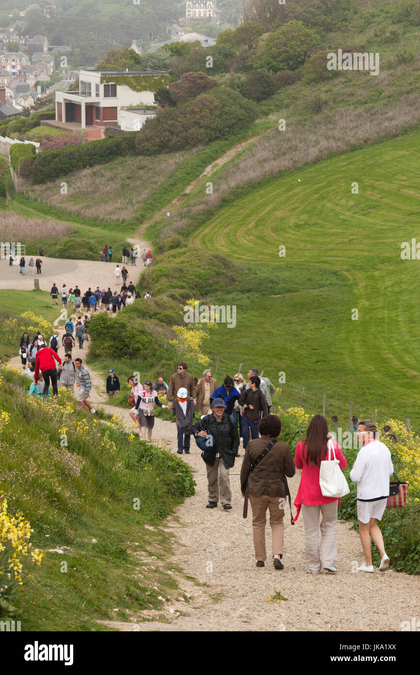 France, Normandy Region, Seine-Maritime Department, Etretat, hikers to the Falaise De Aval cliffs, NR Stock Photo