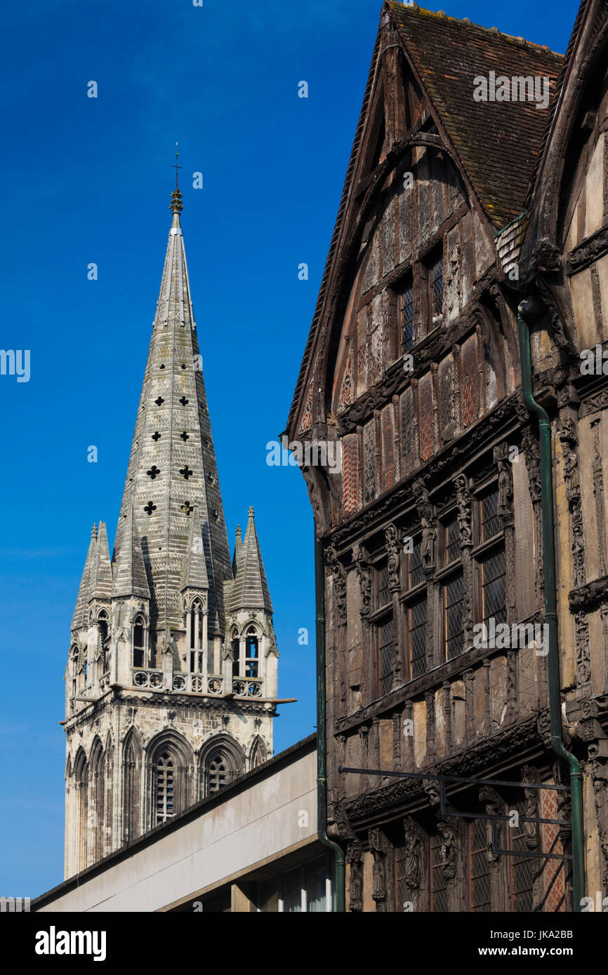 France, Normandy Region, Calvados Department, Caen, building along rue St-Pierre and the Eglise St-Sauveur church - Stock Image