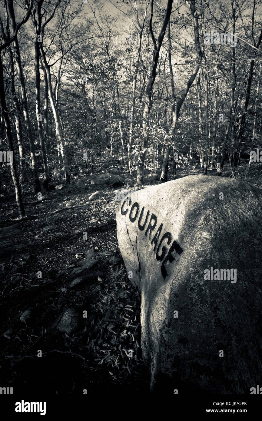 USA, Massachusetts, Gloucester, Dogtown rocks with inspirational words,  Courage - Stock Image