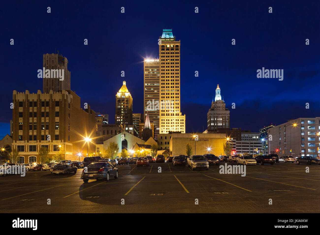 USA, Oklahoma, Tulsa, old and new high rise buildings, Art-Deco district, dusk - Stock Image