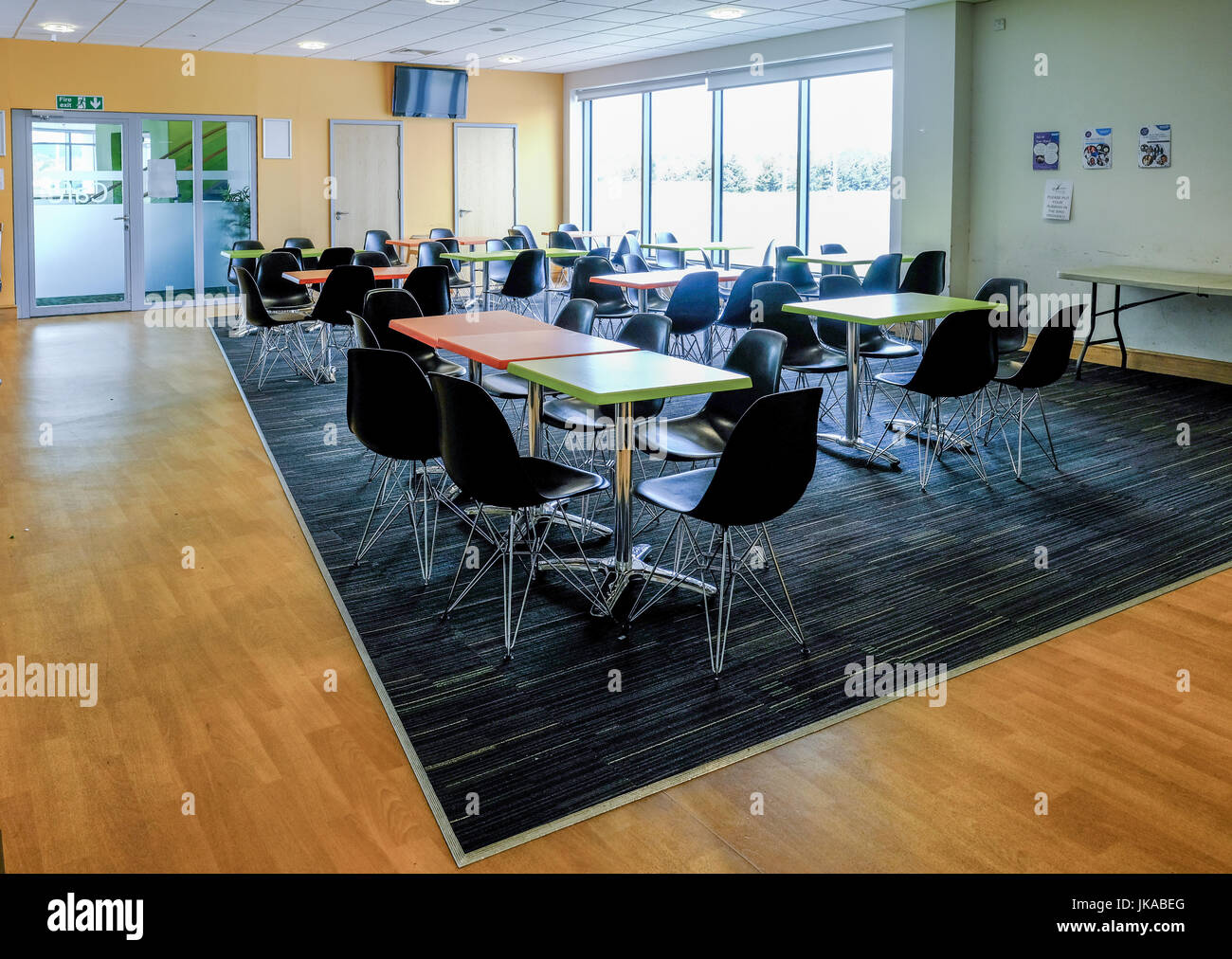 Essex England UK -June 12 2017Empty canteen with tables and chairs. Light and airy room with light coming in from the large windows. & Essex England UK -June 12 2017:Empty canteen with tables and Stock ...
