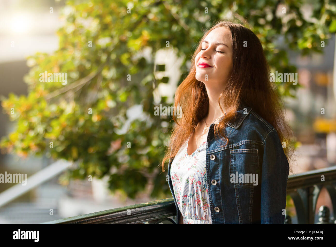 Portrait of the beautiful fashionable girl on embankment in summer day Stock Photo