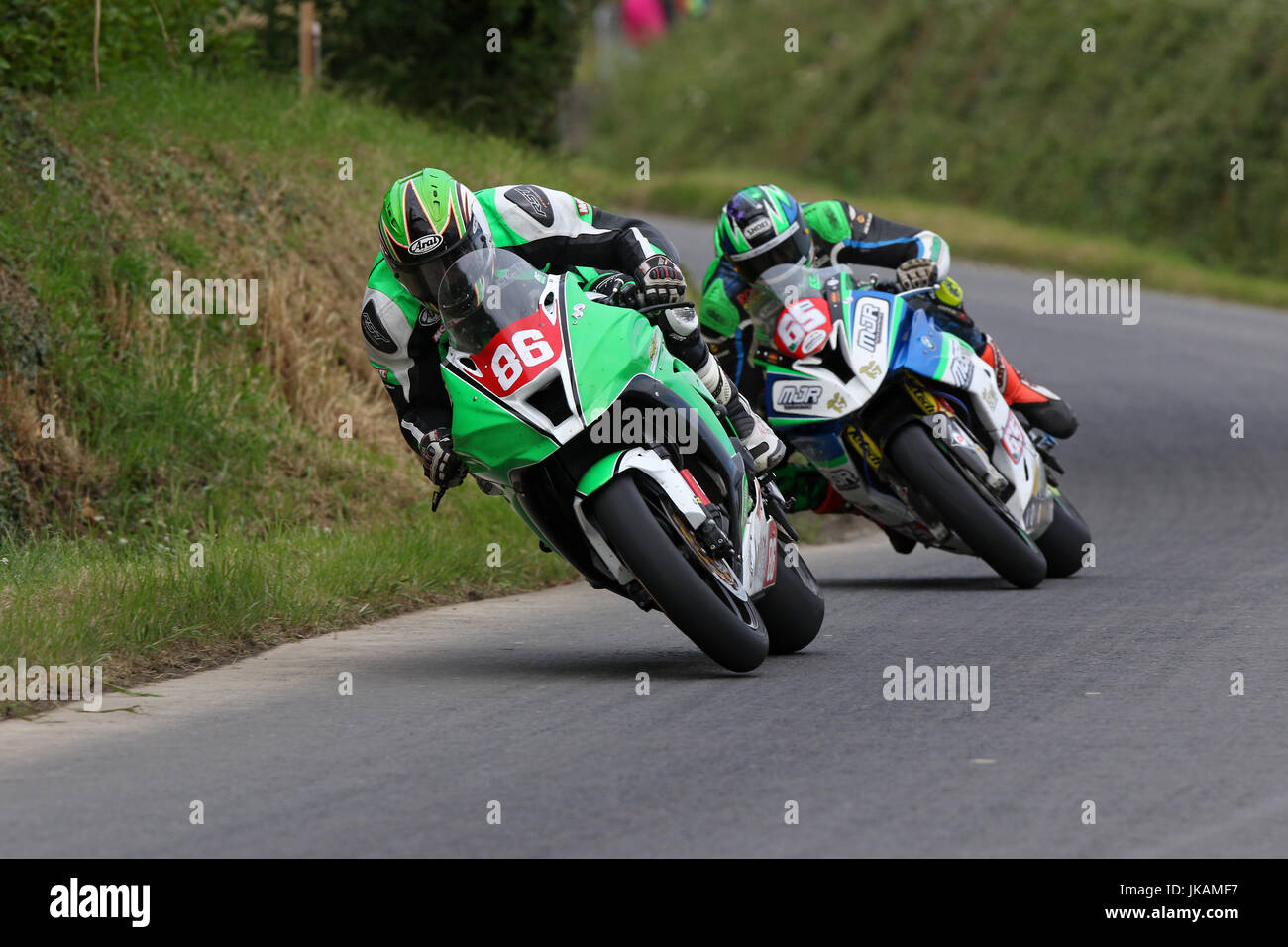 Derek McGee closely followed by Michael Sweeney at the Skerries 100 Road Races Ireland 2017. - Stock Image