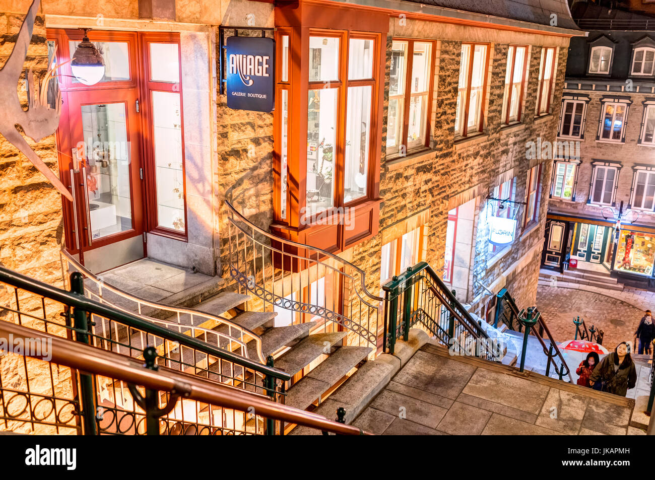 Quebec City, Canada - May 30, 2017: People walking up famous stairs or steps on lower old town street Rue du Petit Champlain by restaurants Stock Photo