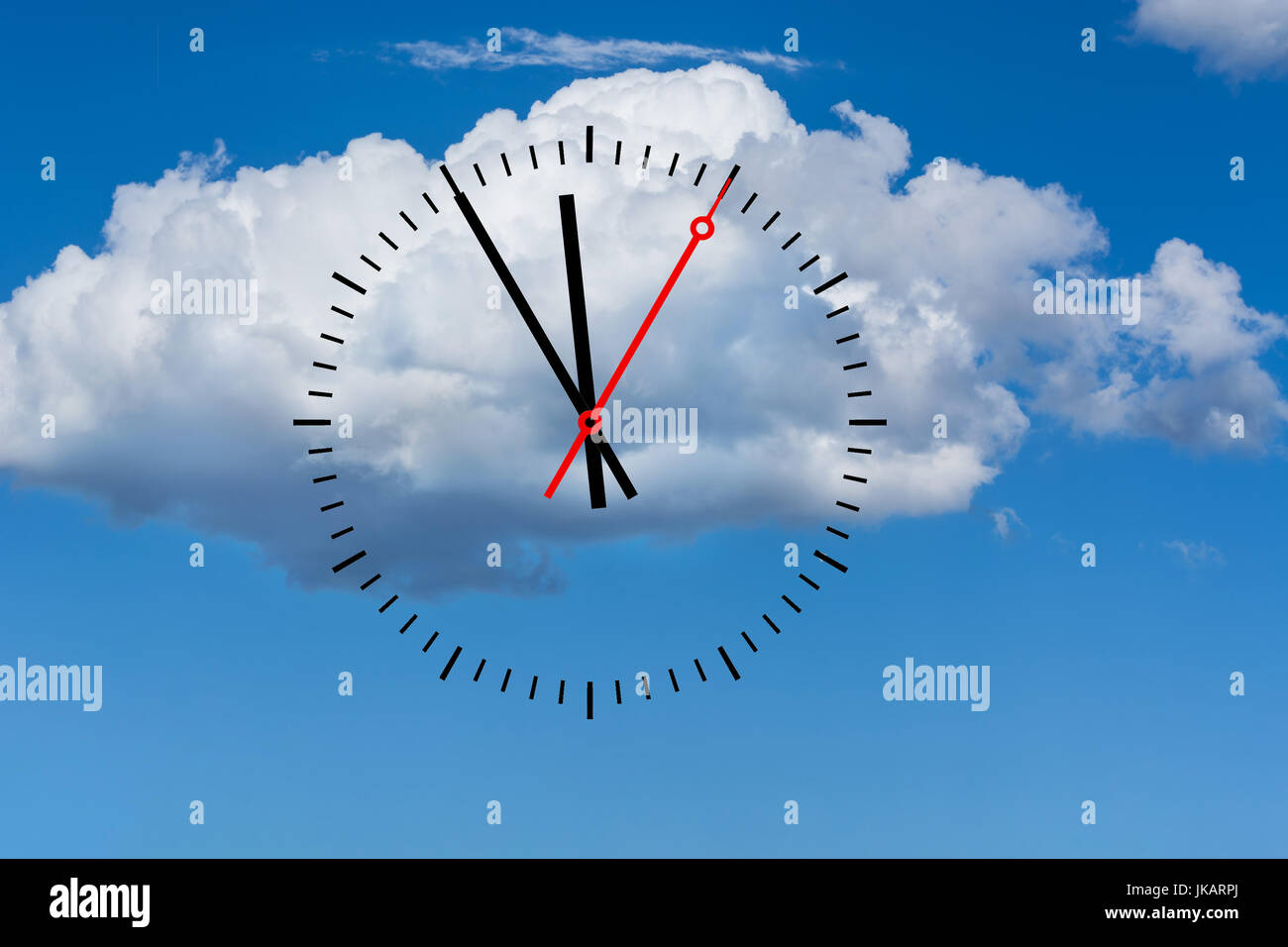 Clock, digits with a minute hand and a red second hand indicates the time 5 before 12. Copy space in front of sky - Stock Image