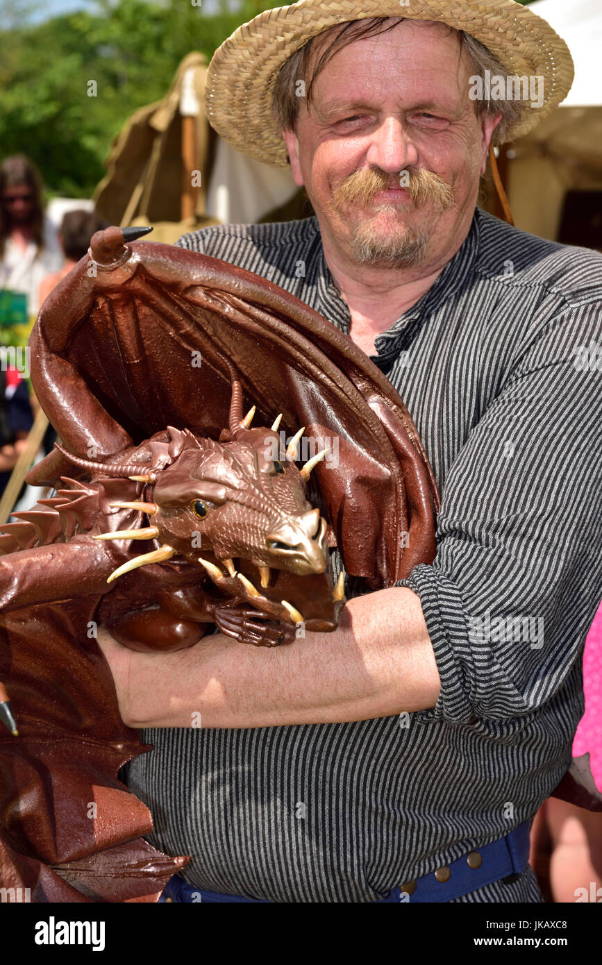 6cb2e8211ef8 Man with dragon hand puppet, Tewkesbury Medieval re-enactment Festival 2017