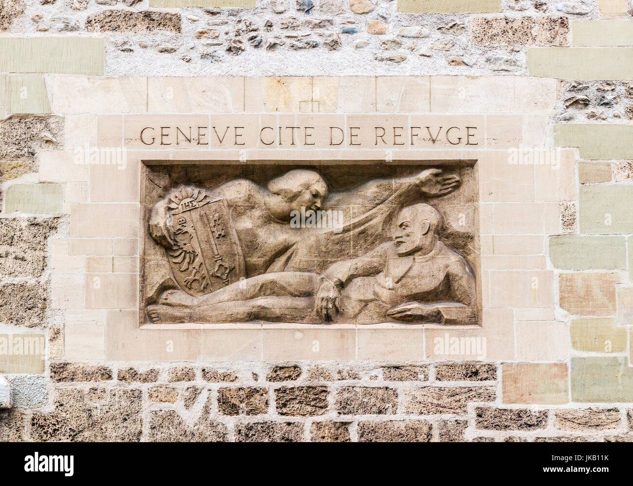 Sculpture with the inscription (ranslation of the text: 'Geneva, city of refuge')' in one of the walls - Stock Image