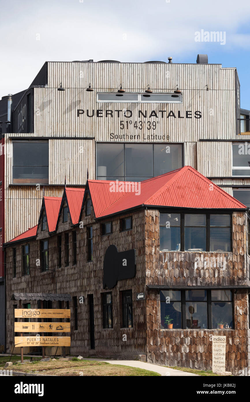 Chile, Magallanes Region, Puerto Natales, sign with town coordinates, Hotel Indigo - Stock Image