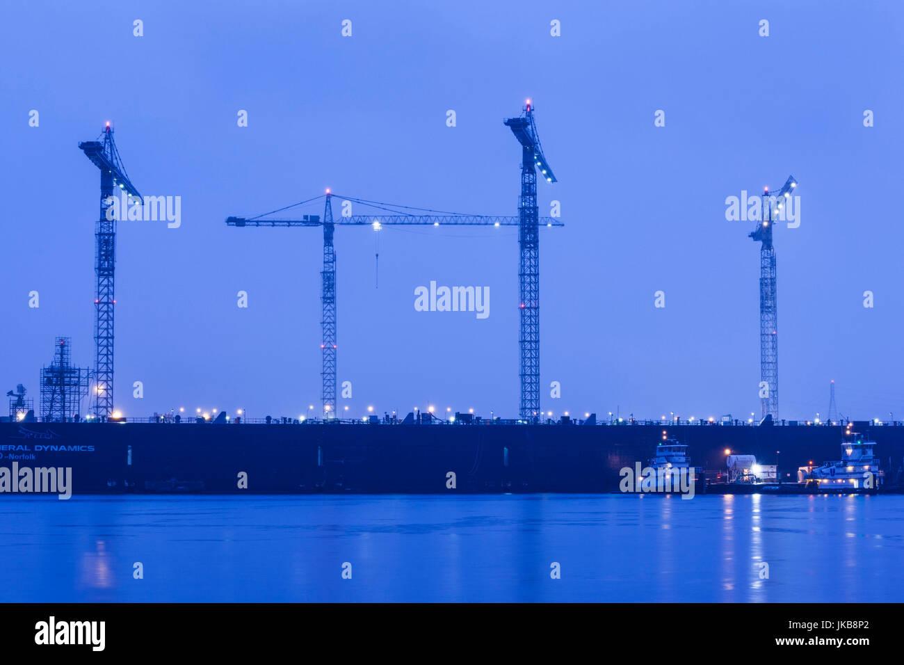 USA, Virginia, Portsmouth, Portsmouth Naval Shipyard, cranes, dawn - Stock Image