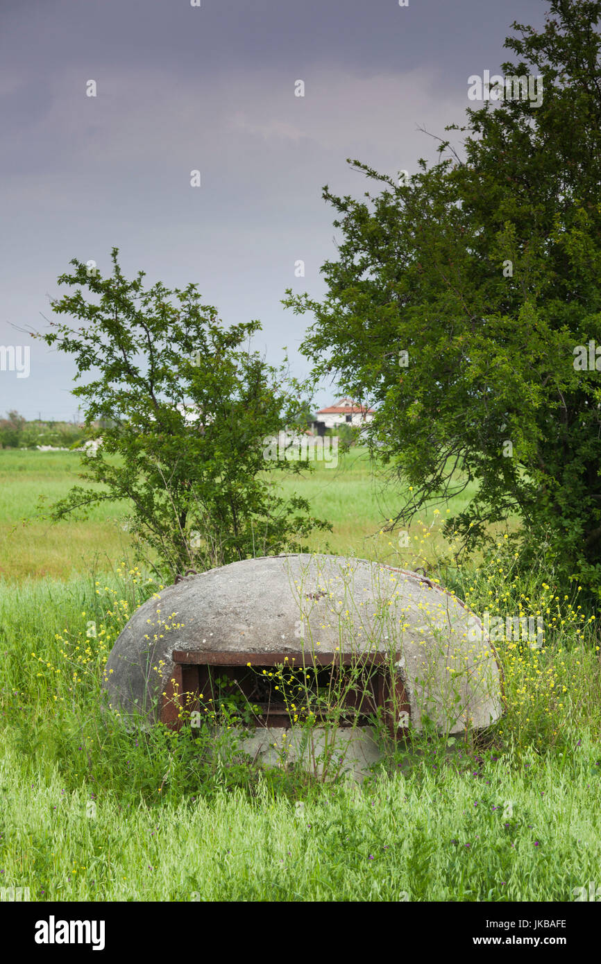 Albania, Fier, Communist-era bunkers in field - Stock Image