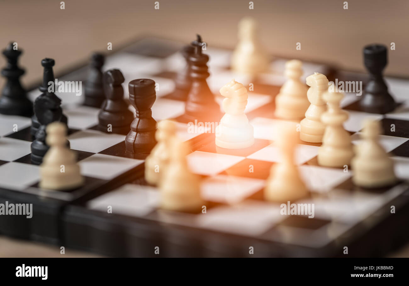 Small knight ,chess on board business concept Stock Photo