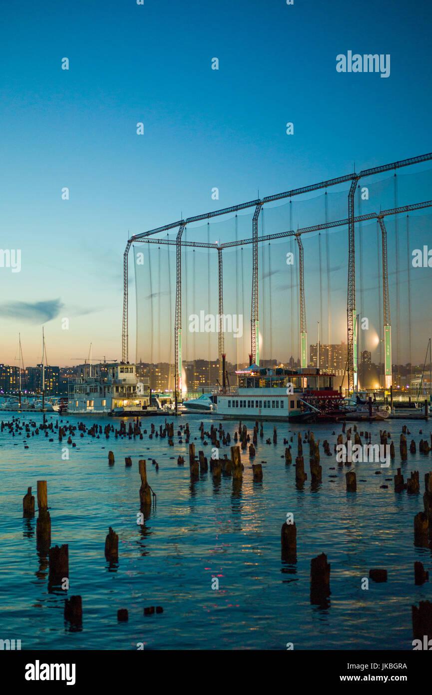 USA, New York, New York City, Lower Manhattan, golf driving range on the Hudson River, dusk - Stock Image