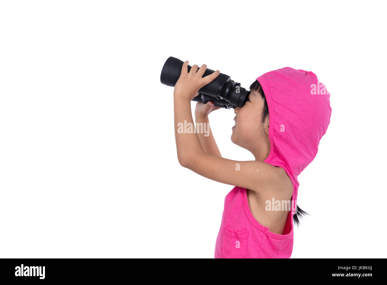 Asian Chinese little girl holding binoculars in isolated white background - Stock Image