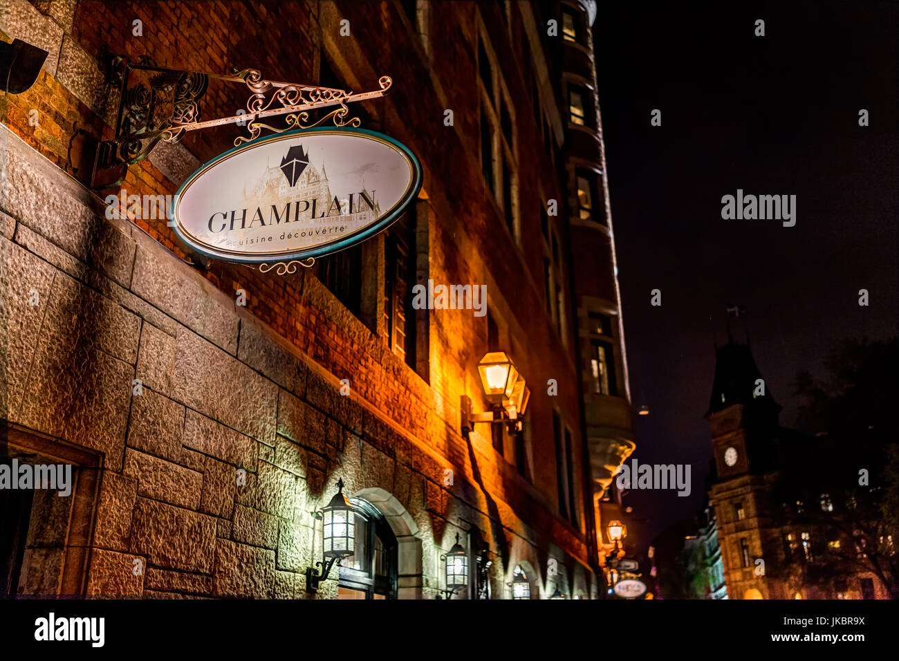 Quebec City, Canada - May 31, 2017: Closeup of Champlain restaurant sign on brick building on lower old town street - Stock Image