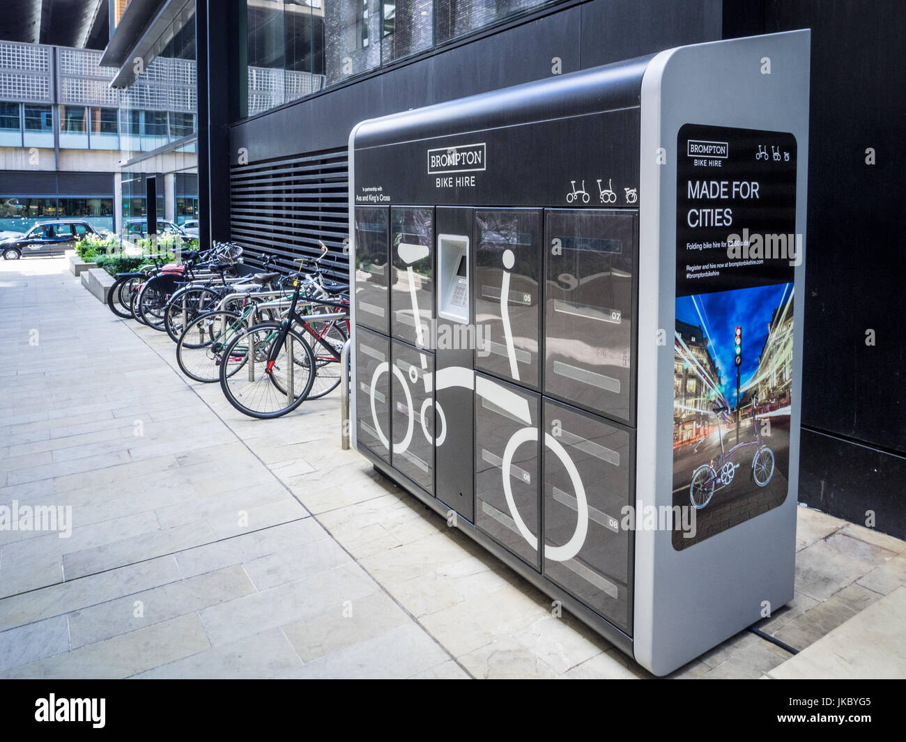 Brompton Folding Bike Hire vending machine outside the Google Offices in London's Kings Cross development - Stock Image
