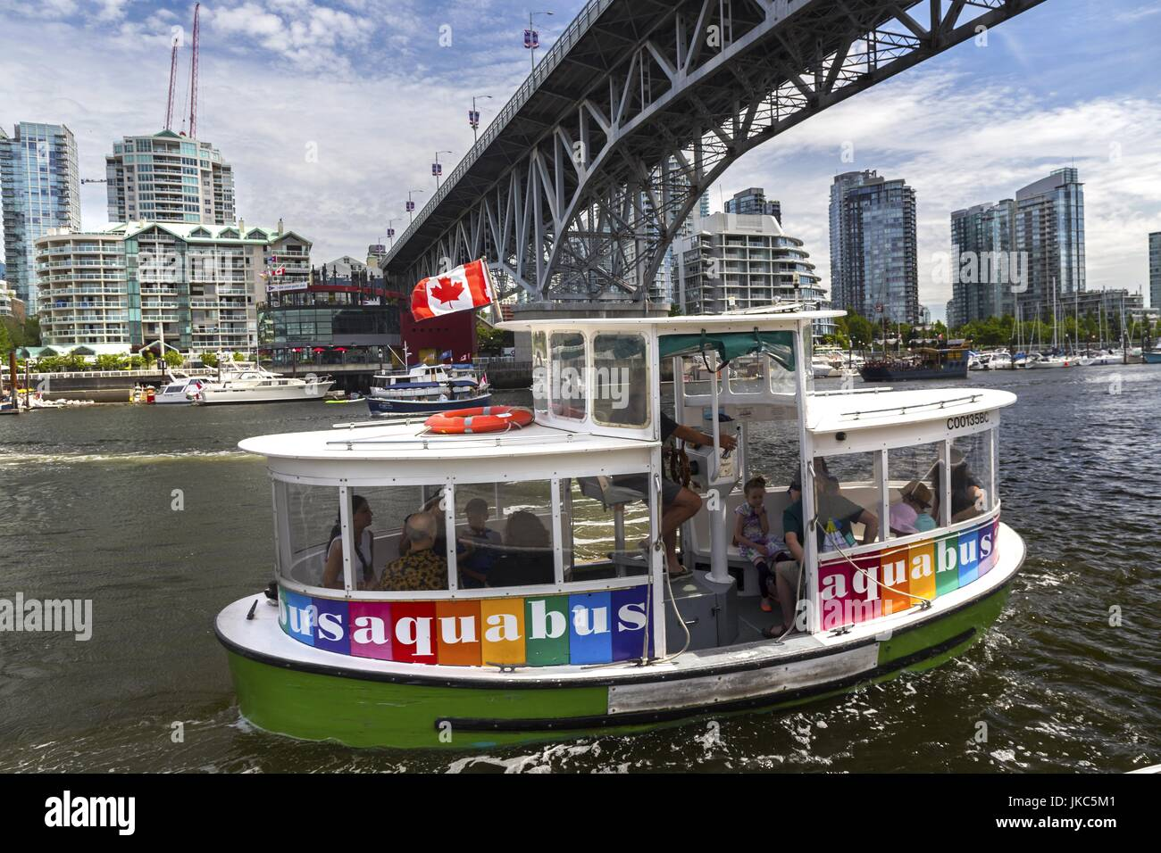 Aquabus Water Taxi Transporting Passengers from Granville Island across False Creek in Vancouver British Columbia Stock Photo