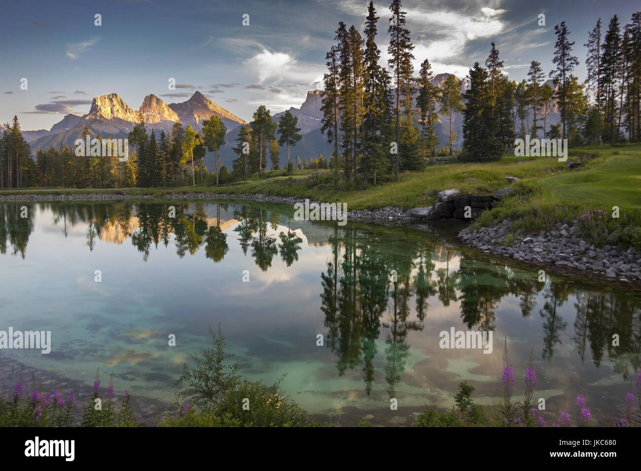 Silvertip Golf Course with view of Three Sisters Mountain above Town of Canmore near Entrance to Banff National - Stock Image
