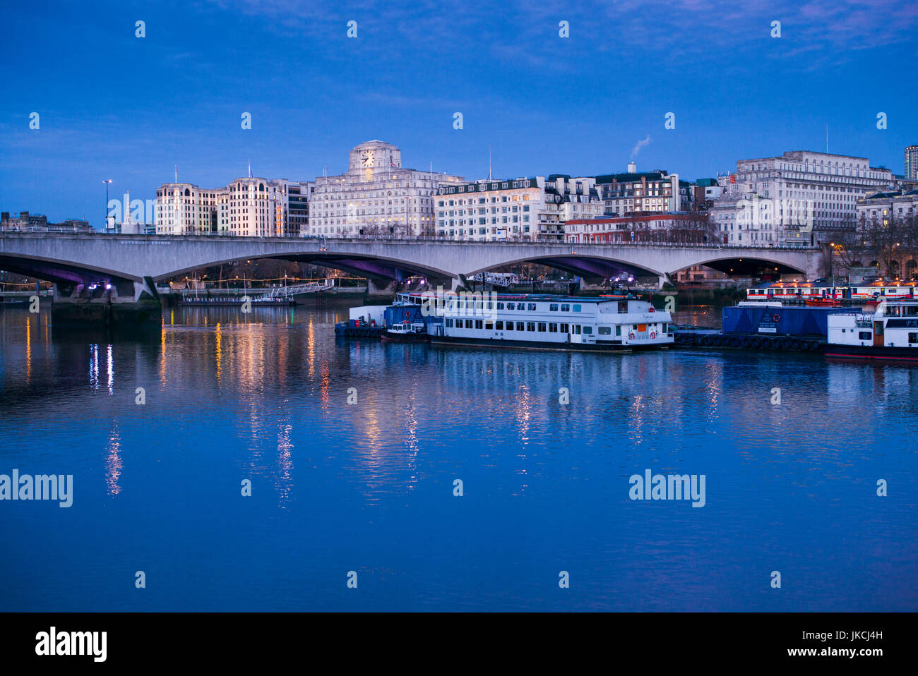 England, London, Victoria Embankment, buildings by Waterloo Bridge and Thames River, dawn - Stock Image