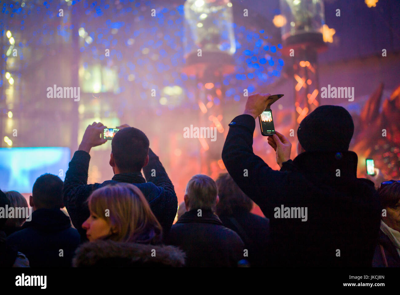 Germany, Berlin, Mitte, Potsdamer Platz, interior of the Sony Center, people using cell phones at indoor performance - Stock Image