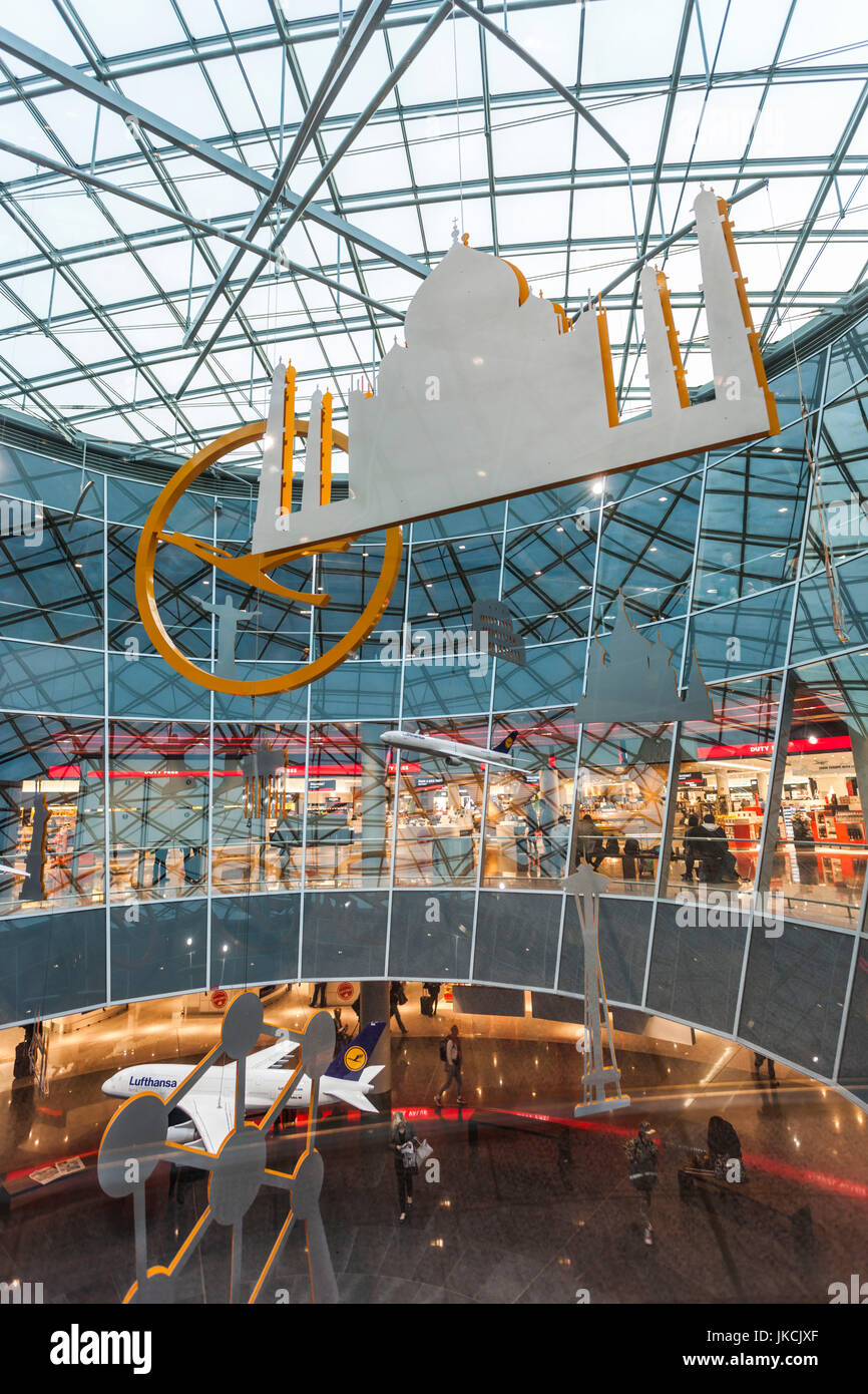 Germany, Frankfurt Am Main, Terminal 1 at Frankfurt International Airport, lobby area with art of world destinations - Stock Image