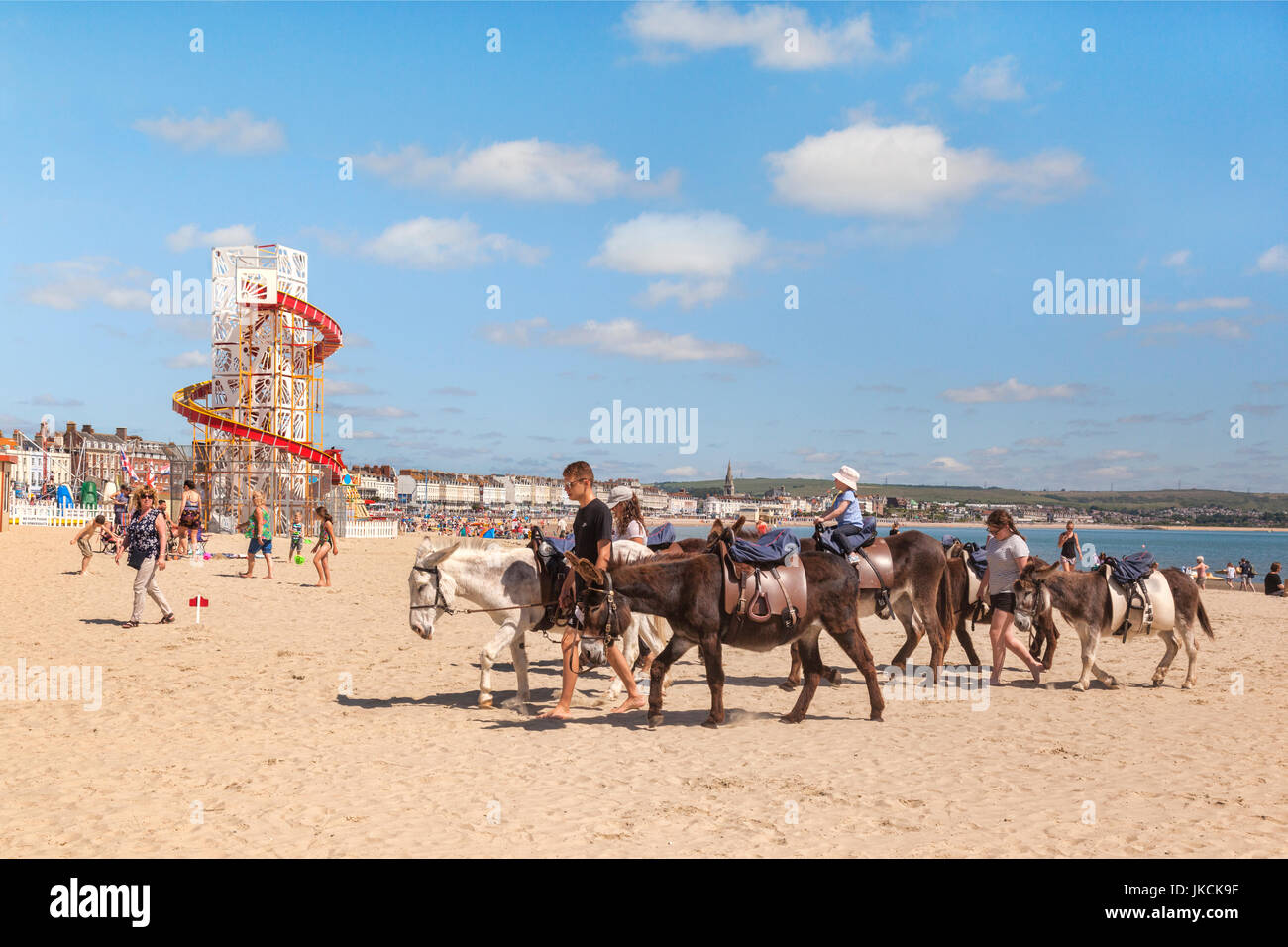 2 July 2017: Weymouth, Dorset, England, UK - Donkey rides on the beach at Weymouth, Dorset, England, UK. - Stock Image