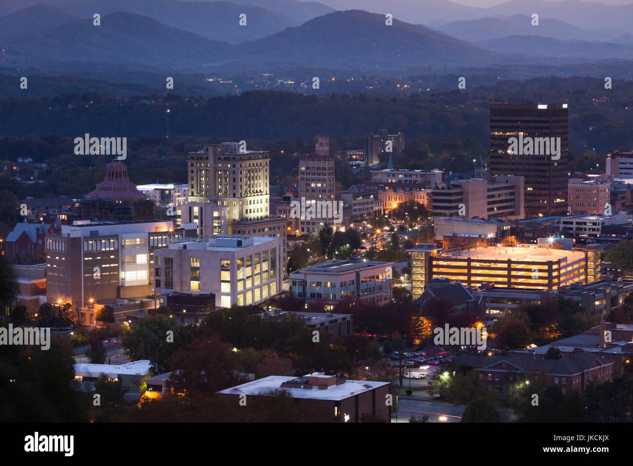 USA, North Carolina, Asheville, elevated city skyline, evening - Stock Image