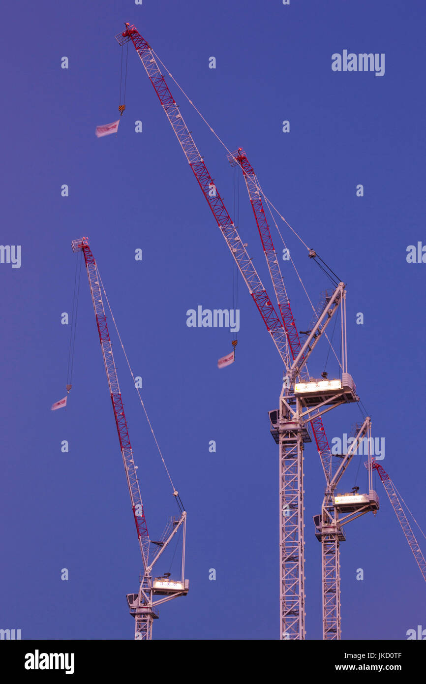 Australia, Western Australia, Perth, construction cranes, downtown, dusk Stock Photo
