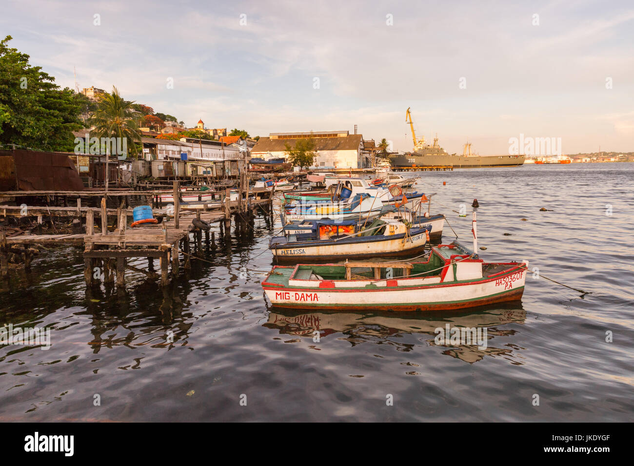 Fishing boats and Cuban navy military ship in Casa Blanca, Havana, Cuba - Stock Image