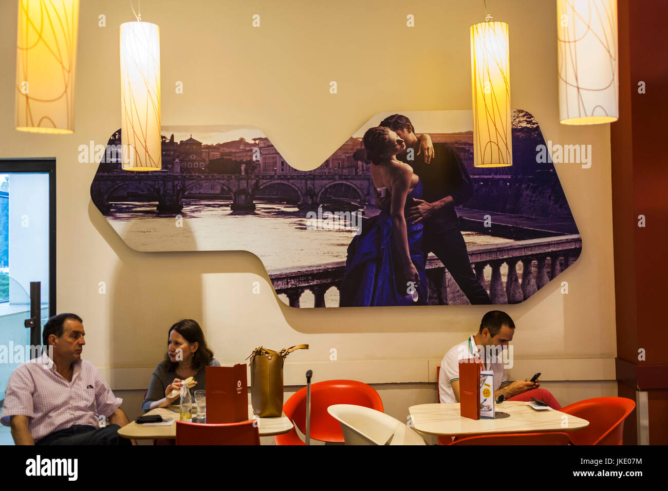 Romania, Bucharest, Bucharest Airport, cafe with seduction mural - Stock Image