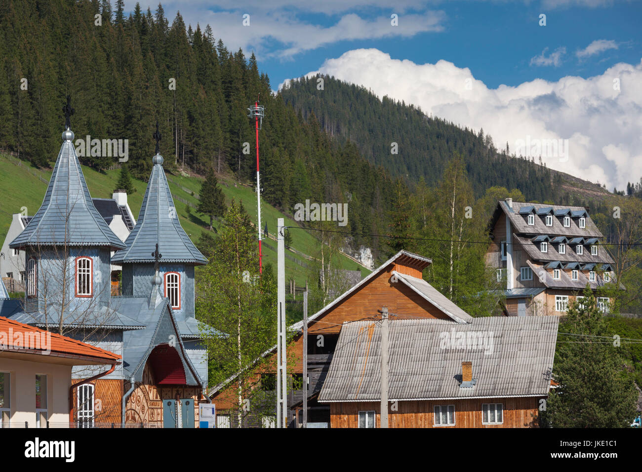 Romania, Bucovina Region, Rodna Mountains National Park, Sesuri, ski resort town, town Orthodox church Stock Photo