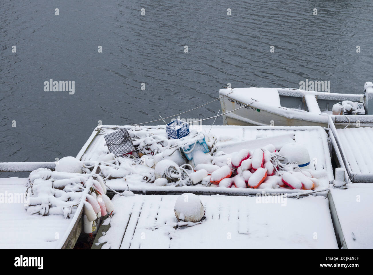 USA, Massachusetts, Cape Ann, Gloucester, early snow fall and lobster buoys on Lobster Cove - Stock Image