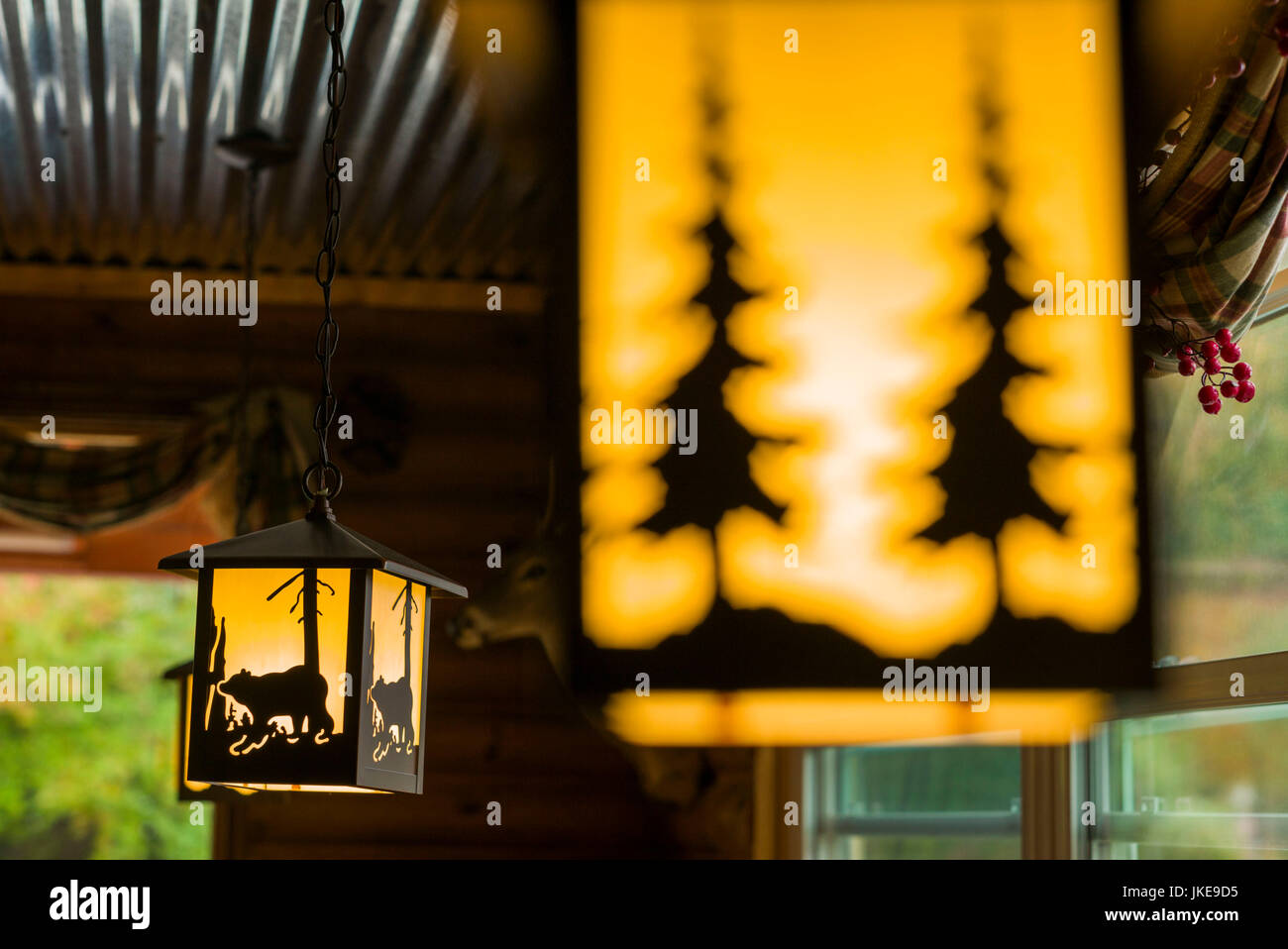 USA, New Hampshire, White Mountains, Bartlett, pine tree-themed lights in roadside diner - Stock Image