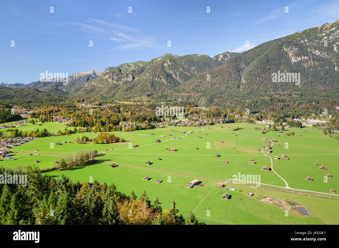 Alpine aerial view of Bavarian valley with fresh green pastureland in Garmisch-Partenkirchen region - Stock Image