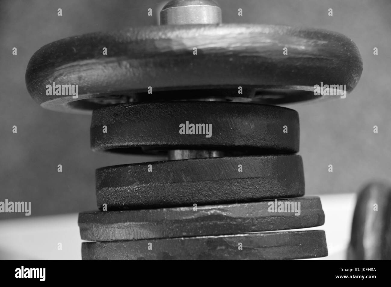 dumbbells in different sizes and weights, Bodybuilding weights for muscle building - Stock Image
