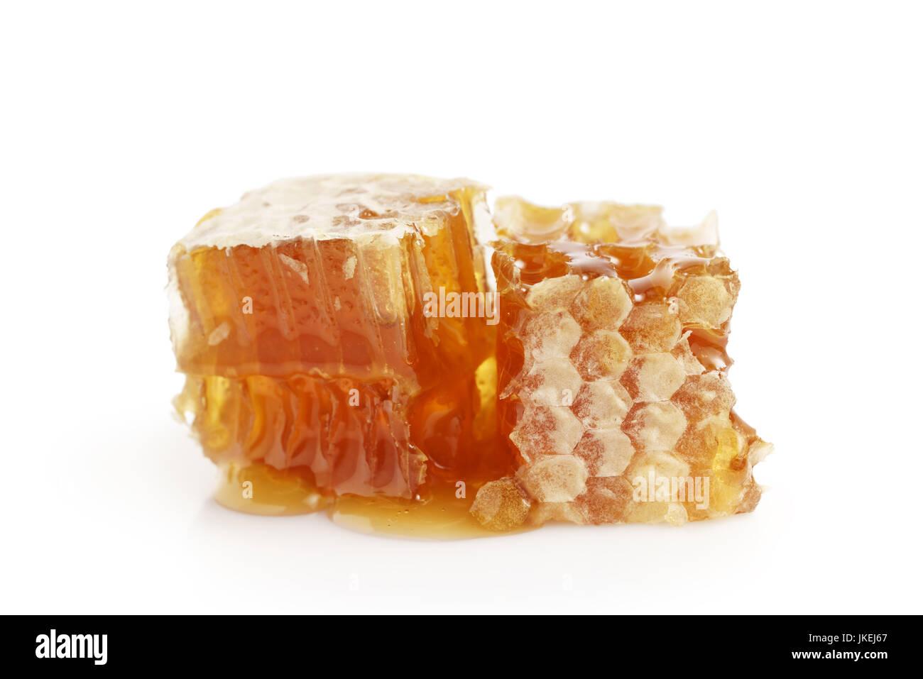 honeycomb with honey isolated on white - Stock Image