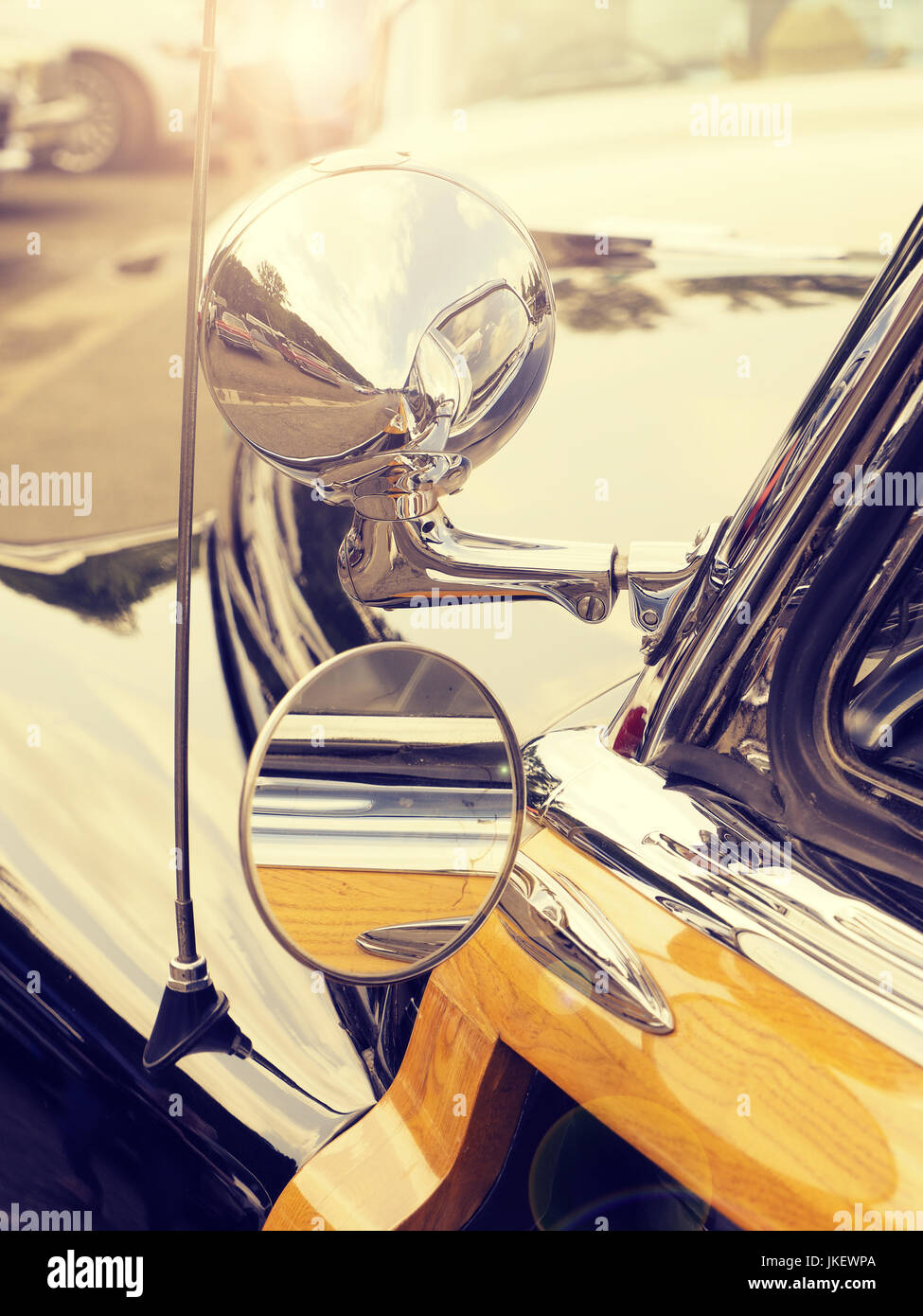 Detail of an old American vintage car on a sunny summer day, lifestyle background retro film stylized - Stock Image