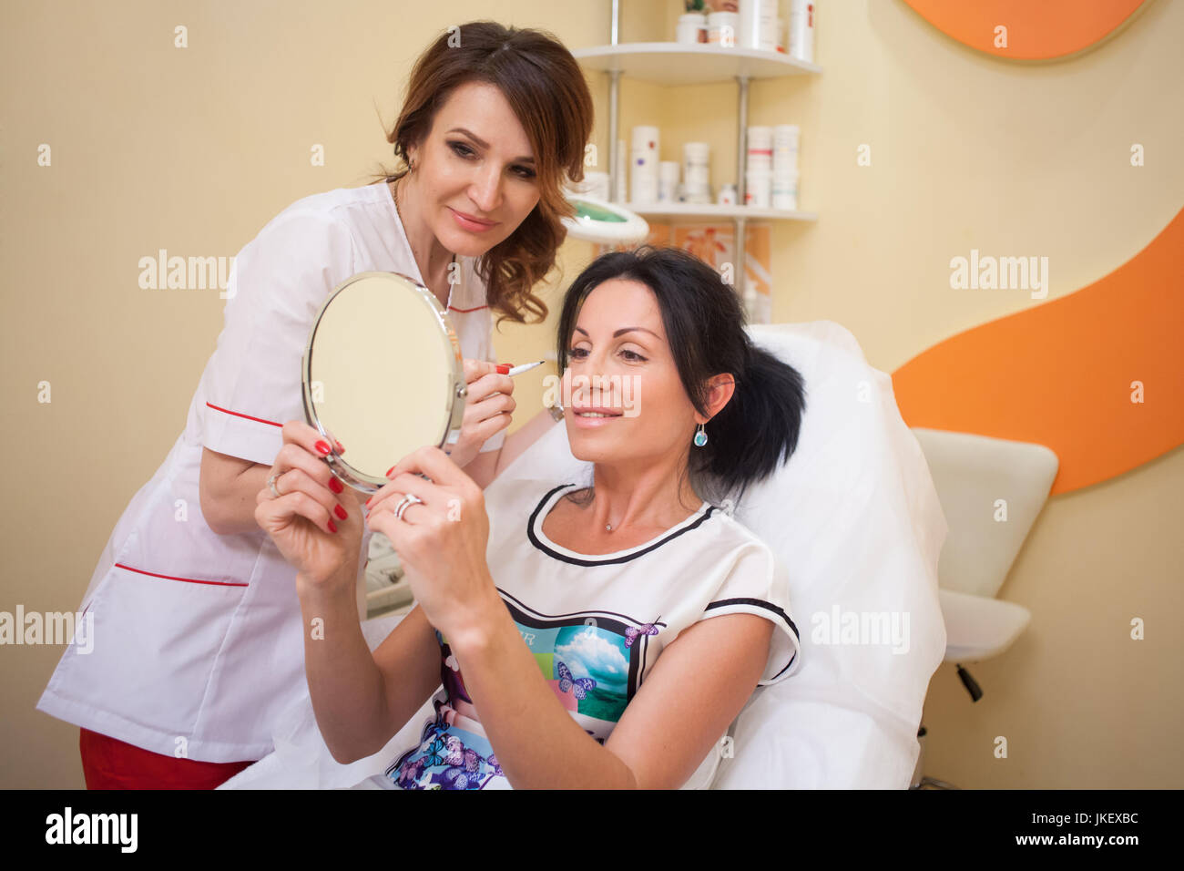 Cosmetology the doctor advises the patient - Stock Image