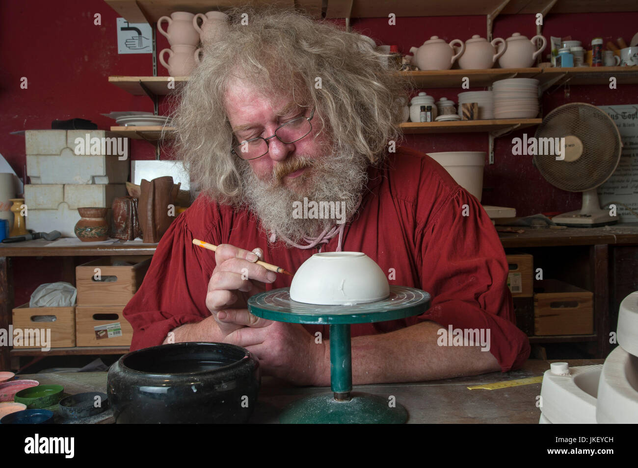 Rene Klohte at work in his Pottery in Halle-Salle, Germany. - Stock Image