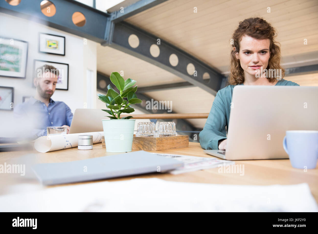 Colleagues working in modern office - Stock Image