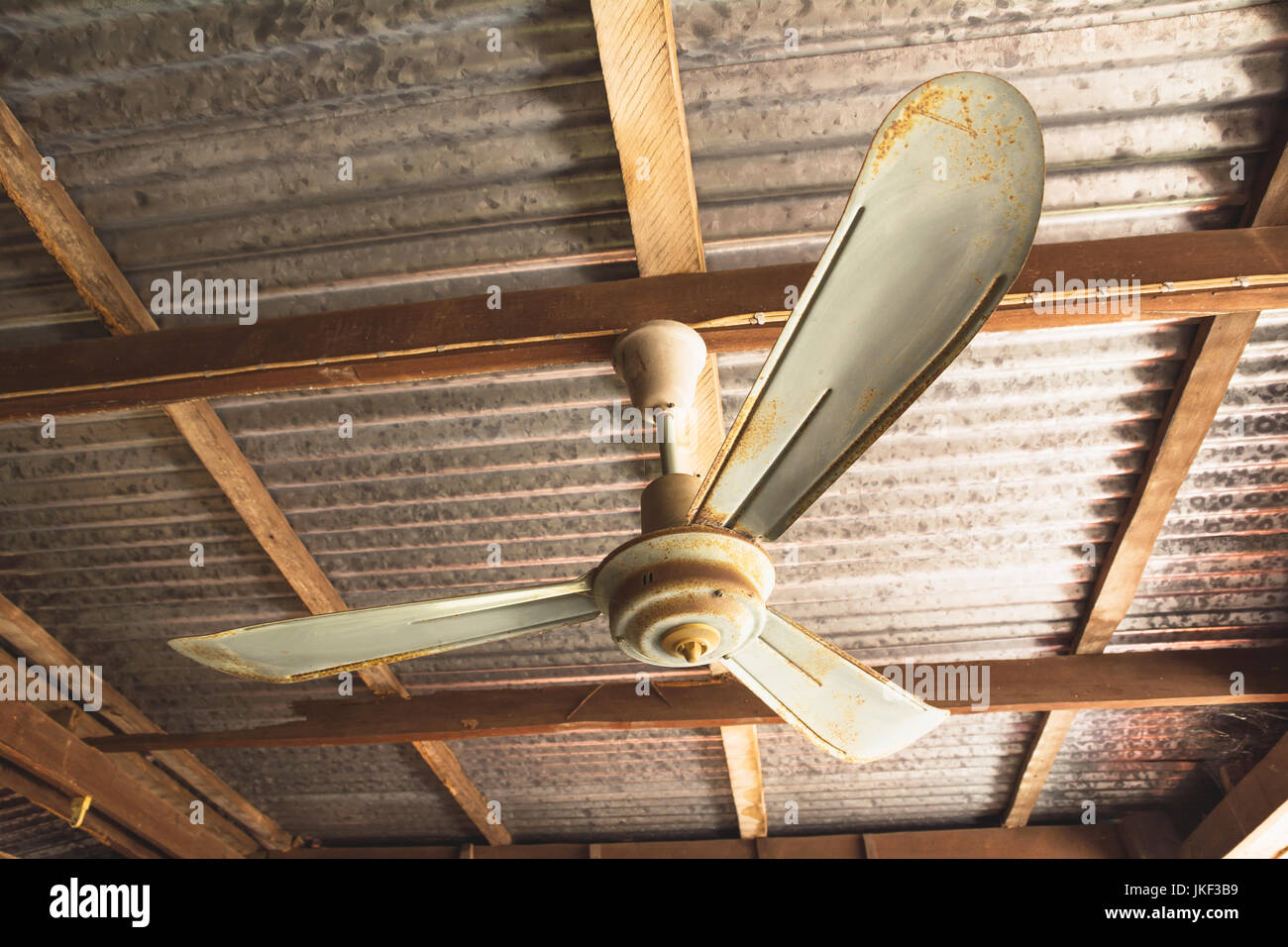 Electric ceiling fan old rusty ceiling fan on rusty on roof in old electric ceiling fan old rusty ceiling fan on rusty on roof in old house aloadofball Choice Image