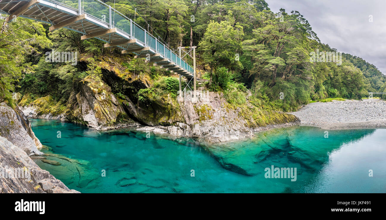 New Zealand, South Island, Mount Aspiring National Park, Blue pools at Makarora river with suspension bridge - Stock Image