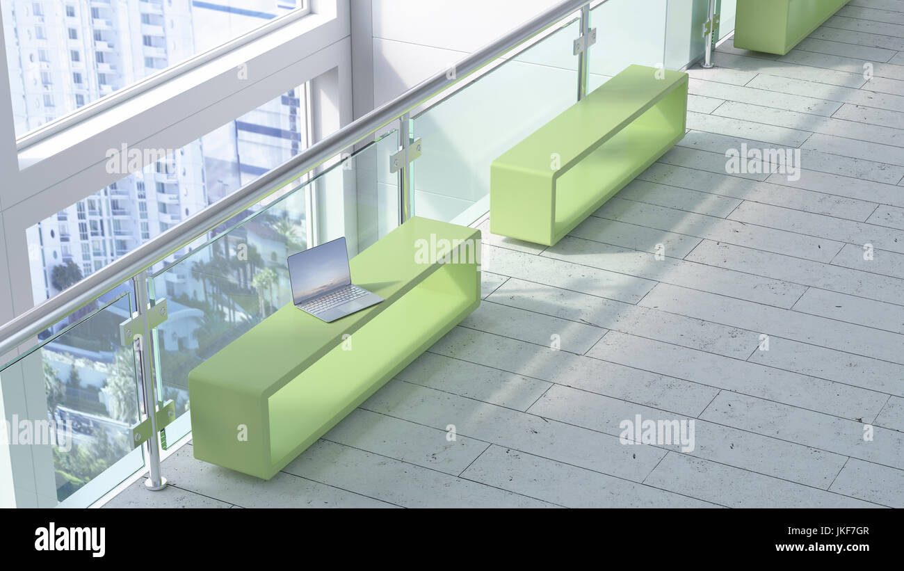 Modern waiting area with laptop on bench - Stock Image