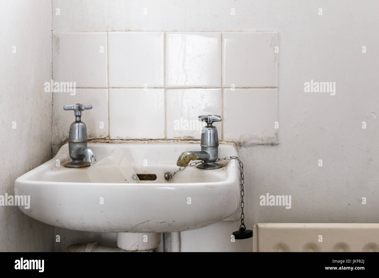 water basin with separate hot and cold water taps as used in Britain ...