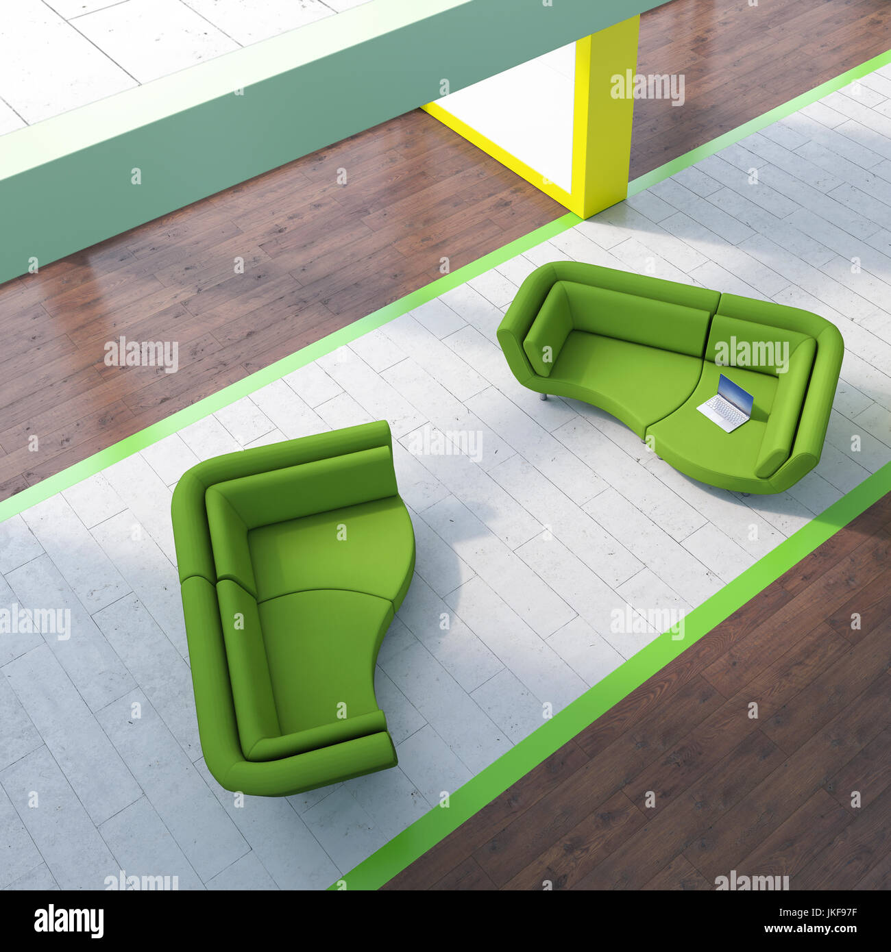 Modern waiting area with laptop on couch - Stock Image