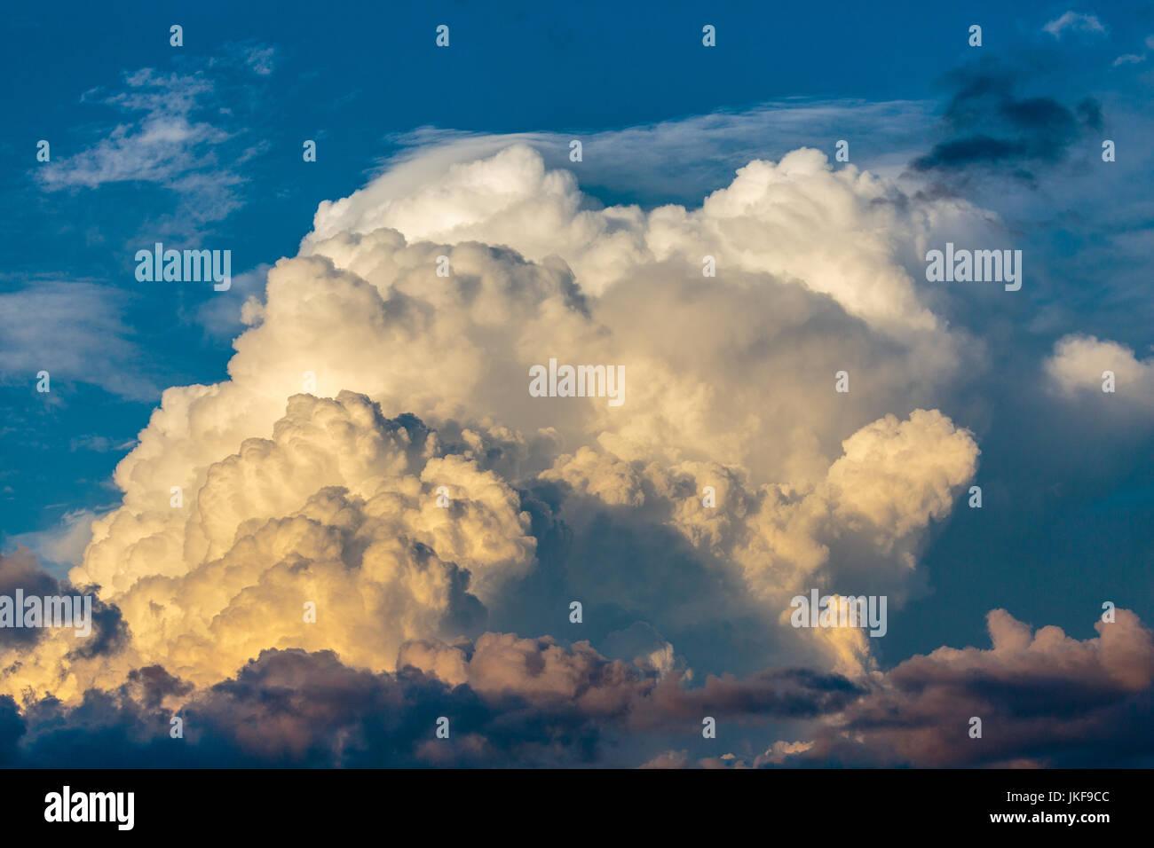 Cumulonimbus cloud against a Wisconsin blue sky in July - Stock Image