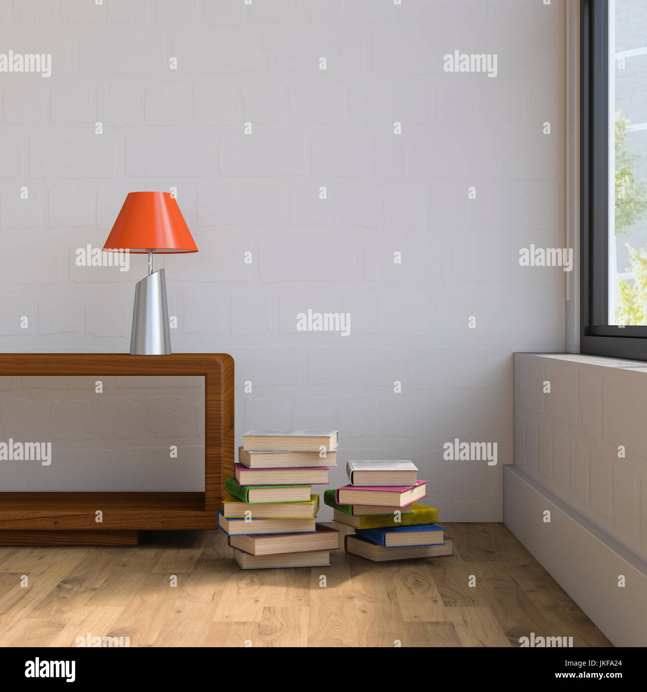 Vintage sideboard with table lamp and stack of books - Stock Image