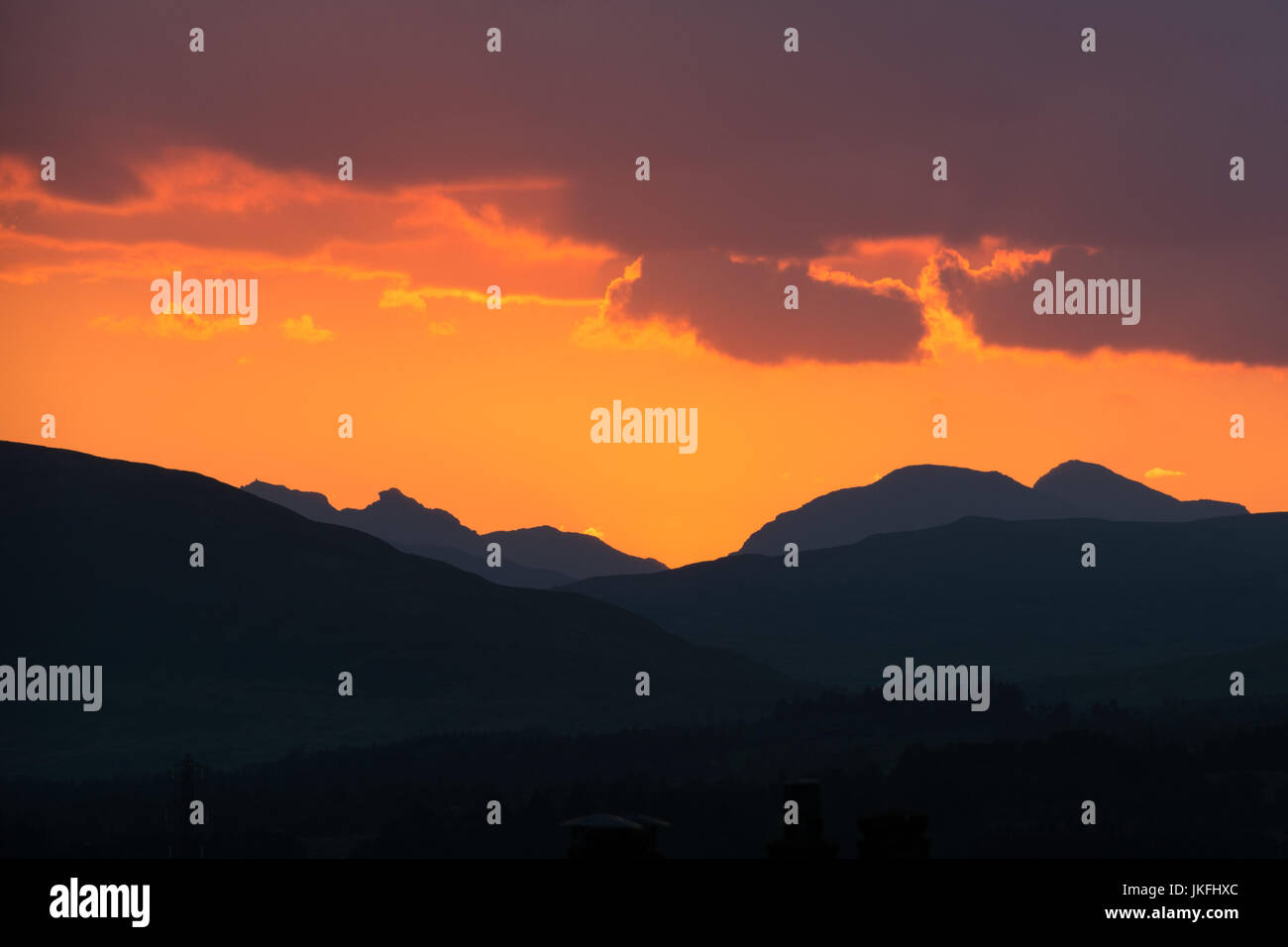 Southern Highlands, Scotland, UK - 23 July 2017: UK weather - beautiful orange sunset over the Southern Highlands - Stock Image