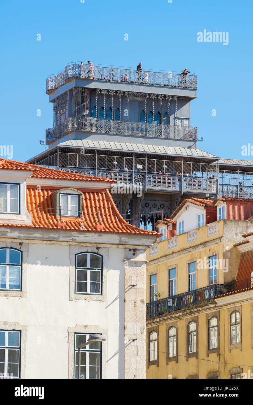Lisbon Elevador de Santa Justa, view of the top of the Elevador de Santa Justa rising above the roofs of the Baixa - Stock Image
