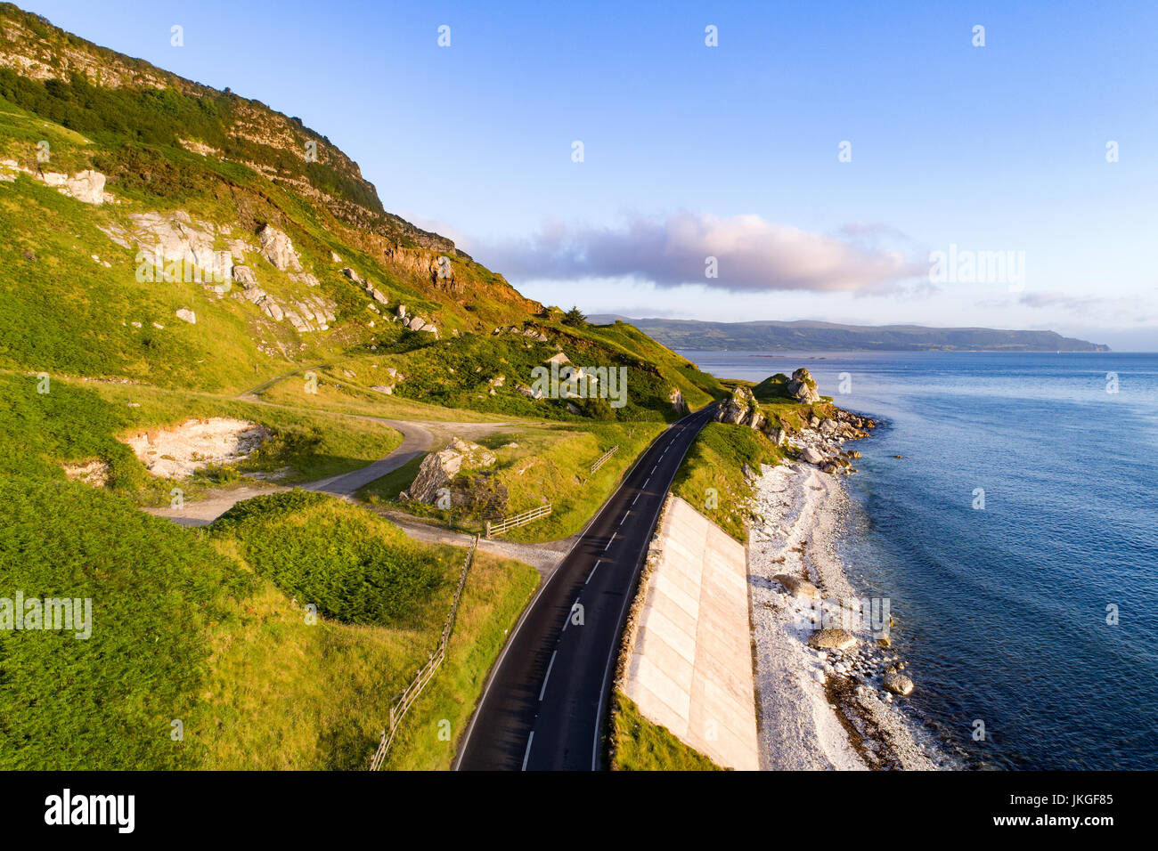 The eastern coast of Northern Ireland and Antrim Coast Road, a.k.a. Giant's Causeway Coastal Route with concrete - Stock Image