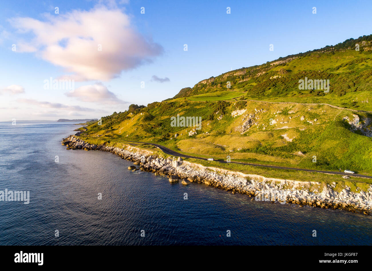 The eastern coast of Northern Ireland and Antrim Coast Road, a.k.a. Giant's Causeway Coastal Route with cars. - Stock Image
